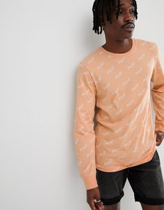 Read more about Huf long sleeve t-shirt with all over bolt logo print in peach - orange