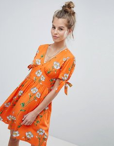 Read more about Wednesday s girl tea dress with tie sleeves in daisy print - orange floral