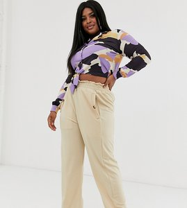Read more about Pink clove wide leg trouser with button detail in beige