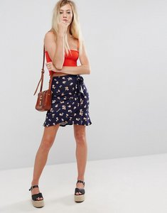 Read more about Asos wrap mini skirt with tie waist in floral print - navy floral