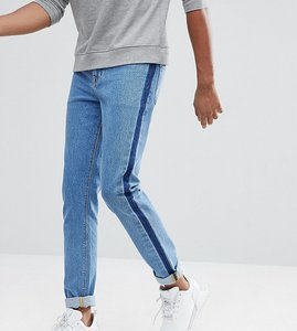 Read more about Asos tall skinny jeans in mid wash blue with side stripe - mid wash blue