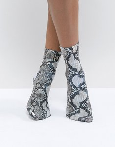 Read more about Asos design snake print socks - beige