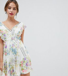 Read more about Asos design petite ruffle sleeve mini dress in floral print with open back - floral