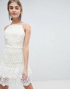 Read more about Dolly delicious all over cutwork lace skater dress with peplum hem - white base yellow un