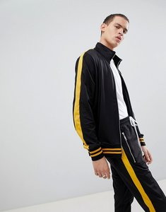 Read more about Criminal damage track jacket in black with yellow side stripe - black
