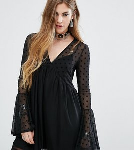 Read more about Rokoko swing dress with sheer mesh spot layer - black