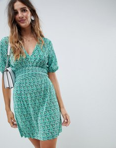 Read more about Asos design mini ditsy print plisse dress with shirred waist - ditsy print
