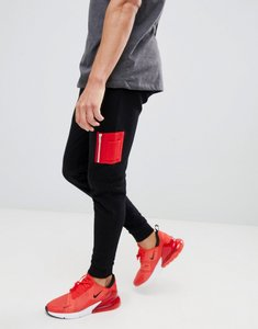 Read more about Asos design skinny joggers with contrast ma1 pocket in black - black chinese red