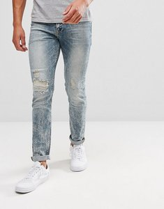 Read more about Asos skinny jeans in mid wash with rip and repair - mid wash blue