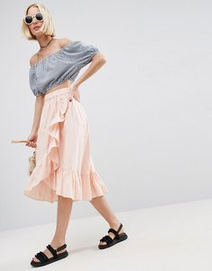 Read more about Asos wrap midi skirt in cotton with ruffle hem - pale pink