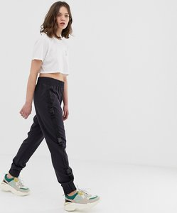 Read more about Noisy may buckle detail trousers
