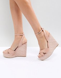 Read more about Aldo cross strap wedge shoe with textured heel - pink