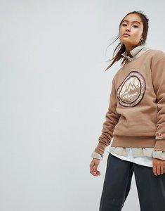 Read more about Ellesse oversized sweatshirt with apres ski logo - tan