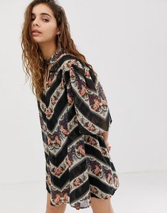 Read more about Asos design collar mini swing dress in 70s paisley stripe