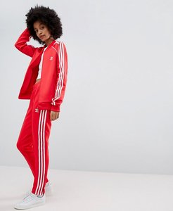 Read more about Adidas originals adicolor three stripe track pants in red - red