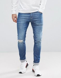 Read more about Asos super skinny jeans in mid wash blue with rip and repair - mid wash blue