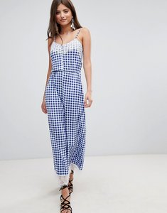 Read more about Asos design lace trim button front cami jumpsuit in gingham - blue white