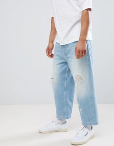 Read more about Asos design wide leg cropped jeans in light wash blue with rips - mid wash blue