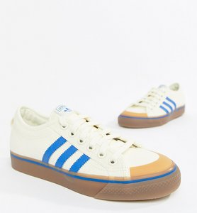 Read more about Adidas originals nizza canvas trainers in white and blue - white