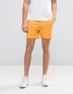 Read more about Asos slim shorter chino shorts in bright yellow - beeswax
