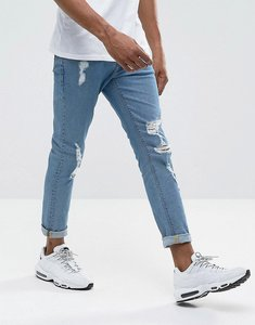 Read more about Asos design skinny jeans in mid wash with heavy rips - mid wash vintage