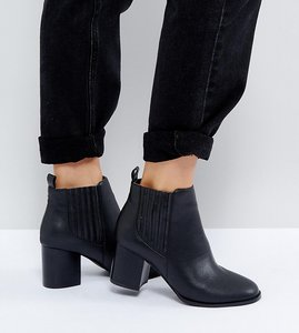 Read more about Asos roland mid heeled chelsea boots in water based pu - black