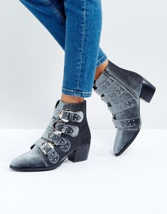 Read more about Truffle collection stud buckle strap mid heel boot - grey velvet