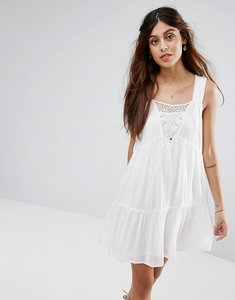 Read more about Vila lace detail tiered smock dress - white