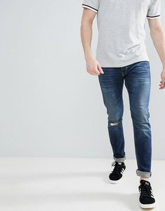 Read more about United colors of benetton slim fit with rips in mid wash - 901