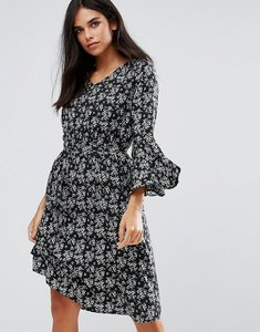 Read more about Yumi flare sleeve dress in floral print - black