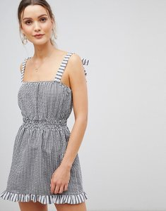 Read more about Asos design gingham tie shoulder shirred beach dress - black white