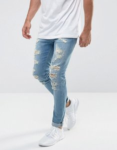 Read more about Asos super skinny jeans in mid wash blue with extreme rips - mid wash blue