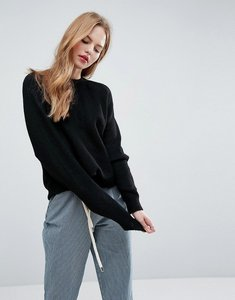 Read more about Asos jumper in fluffy yarn with crew neck - black
