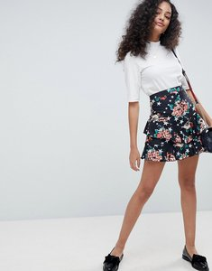 Read more about Asos mini skirt in rose and star print - multi