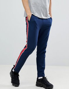 Read more about Asos design slim cropped trousers in navy with red side stripe - navy