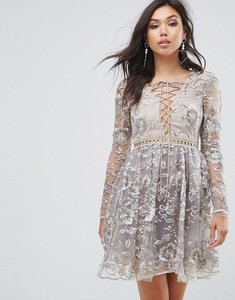 Read more about True decadence all over embroidered mini skater dress with lace up plunge front - gold