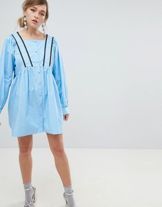 Read more about Sister jane babydoll dress with button front and cross back detail - blue