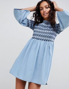 Read more about Asos design denim smock dress with embroidery in midwash blue - blue