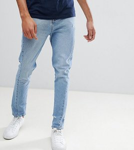 Read more about Asos design tall skinny twisted seam jeans in light wash blue with abrasions - light wash blue