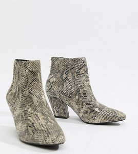 0a9a5b7aeecd Read more about Asos design reminisce chelsea ankle boots in snake print -  snake