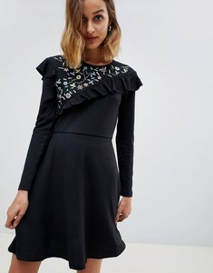 Read more about Angel eye long sleeve dress with lace insert - black