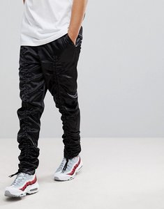 Read more about Asos extreme drop crotch trousers in nylon with bungee cord - black