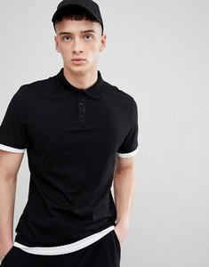 Read more about Asos longline polo shirt with contrast cuff and hem extender in black white - black