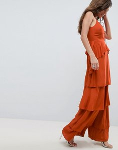 Read more about Asos design tiered jumpsuit with lace up front - rust