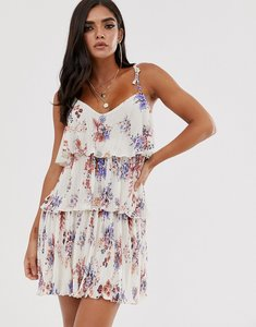 Read more about Asos design plisse tiered mini dress in floral with shoulder ties
