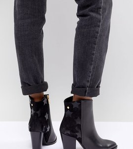 Read more about Tommy hilfiger leather heeled ankle boots - black