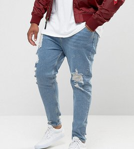 Read more about Asos plus tapered jeans in vintage light wash blue with heavy rips - light wash vintage
