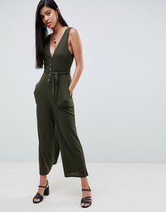 Read more about Asos design v neck jumpsuit with button front in slouchy rib - green