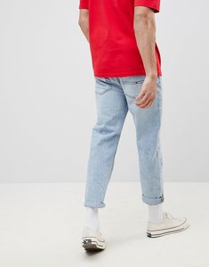 Read more about Tommy jeans 90s sailing capsule cropped tapered jeans in light wash - light blue denim