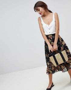 Read more about Vila floral midi skirt with ruffle hem - black